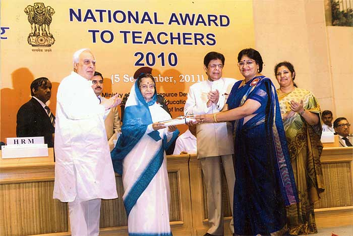 Mrs. Rajani Shekhar receiving the National Teachers Award 2010 from Mrs Pratibha Patil, President of India.